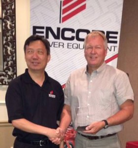 Encore President Hardy Shao Presents The Distributor Rep of the Year Award to Smith South-Central's Robert Smit